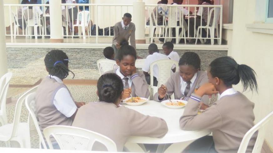 Students of Excella School in Kigali take lunch at school. (Solomon Asaba)