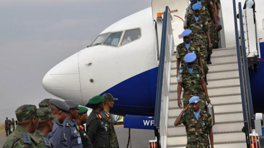 RDF Air Force personnel upon arrival home at Kigali International Airport (L) as another batch departs for Mission. (Courtesy)