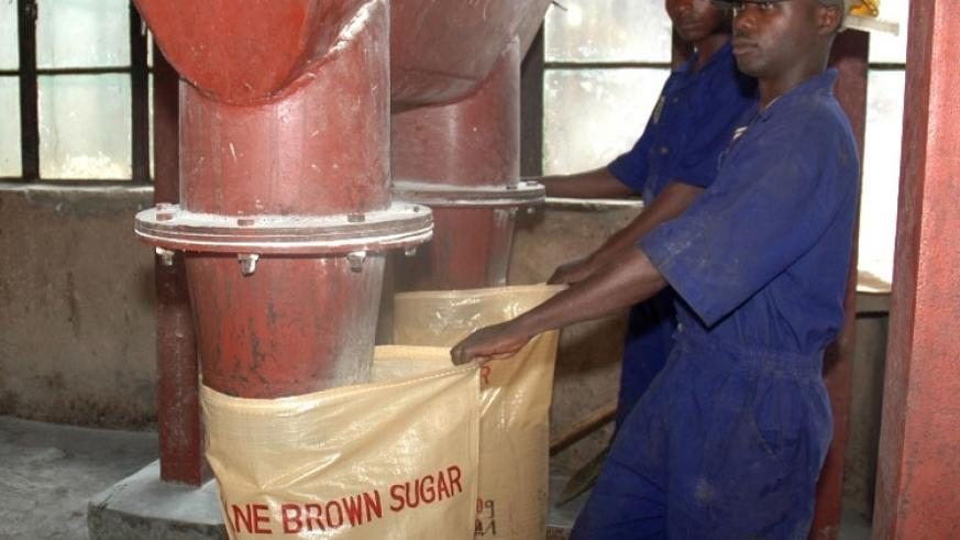 Workers at Kabuye Sugar Factory package sugar. A recent deal allowing Ugandan surplus sugar to access the Kenyan market has sparked off a row in the two EAC nations. (File)