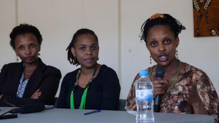 Pastor Mugisha (R) speaks during a press conference as Chikanya (C) and her assistant Regina Mukansanga look on. (Faustin Niyigena)