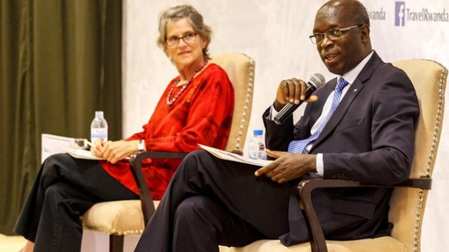"Premier Anastase Murekezi speaks on a panel discussion as fellow panelist Dr Amy Vedder, a researcher, looks on during the the ""Conversation on Conservation"" forum in Kigali yesterday. (Timothy Kisambira)"