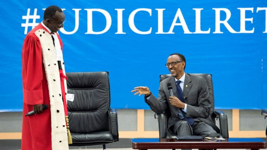 President Kagame and Chief Justice Sam Rugege share a light moment at the launch of the new judicial year for 2015/16 at the Rwanda Defence Forces Combat Training Centre in Gabiro, Eastern Province, yesterday. (Village Urugwiro)