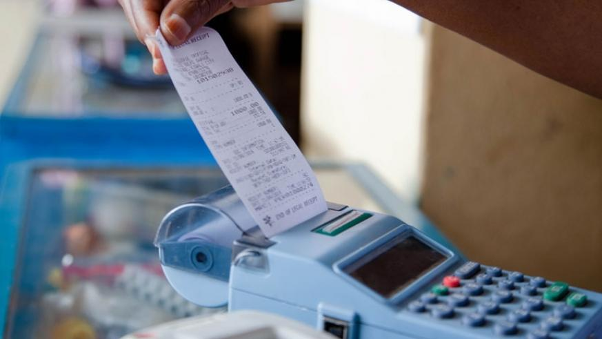 A trader pulls a receipt out of an electronic billing machine. (File)