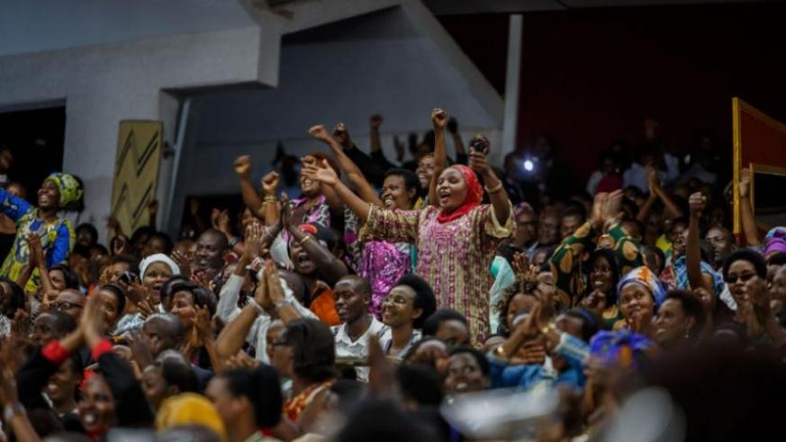 People applaud during the term-limits amendment sitting at Parliament in July.  (File)