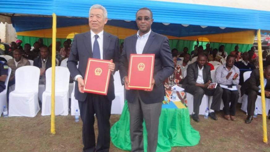 Amb. Shen and Minister Biruta show documents for the constructed boreholes on Monday. (Jean Fidele Ndungutse)
