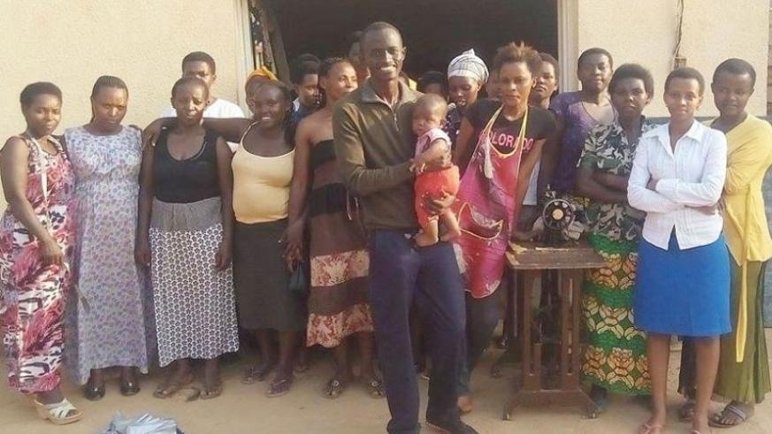 Bertrand Ishimwe (holding a child) with some of the women they help. (All photos by Joseph Oindo)