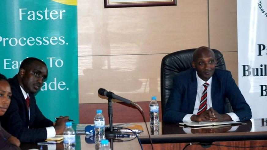 RRA's boss Tusabe (R) and TransUnion's Nkuranga at the signing of the agreement ceremony in Kigali  yesterday. (Peterson Tumwebaze)