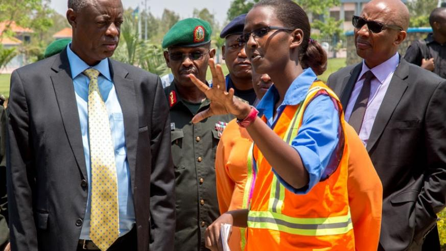 Eng. Linda Ingabire (R) explains to Minister Kabarebe and other officials the number of students that will occupy the newly constructed dormitories and dining hall at Gako. (All photos by Doreen Umutesi)