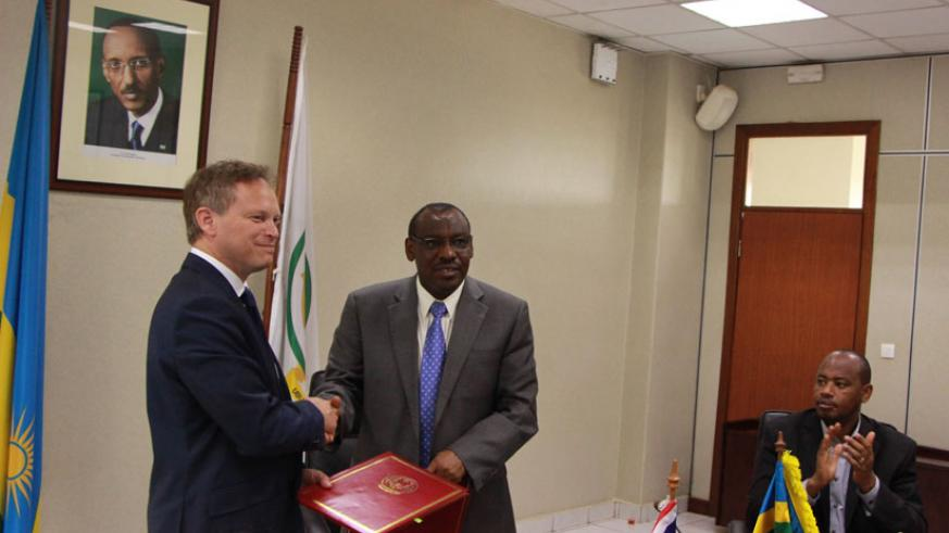 Grant Shapps and Gatete at the signing ceremony in Kigali yesterday. (Peterson Tumwebaze)