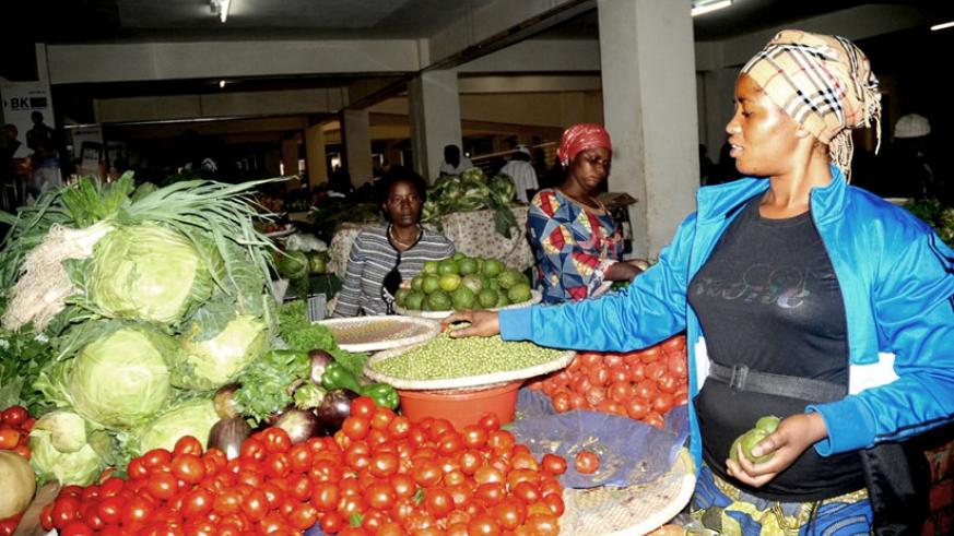 A woman sells vegetables at the City Market. Rwanda has been lauded for pro-women legislation. (File)