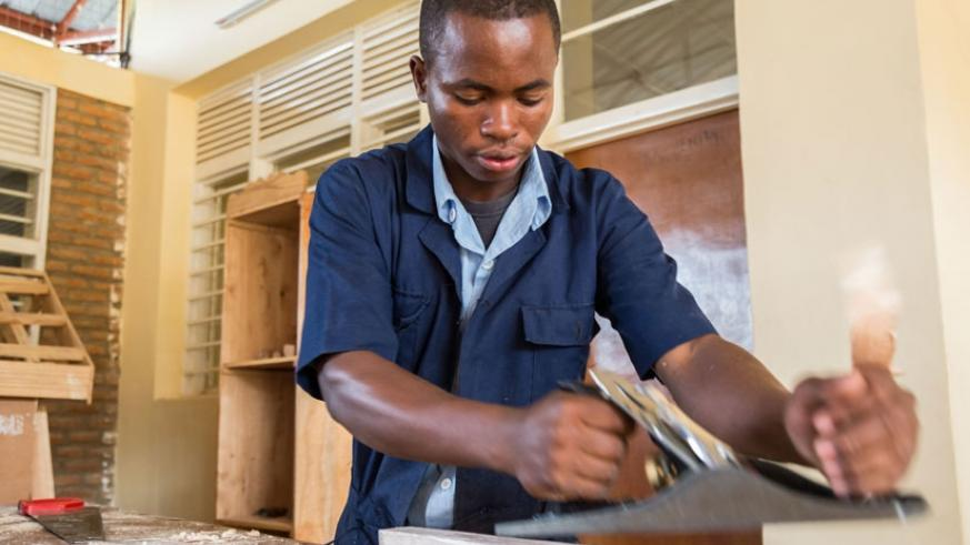 A student of VTC Muganza in Rusizi District makes a chair. Government is promoting TVET as an ideal education path. (File)