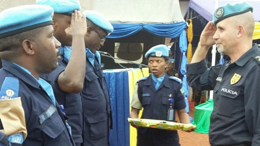MINUSCA Police commissioner Luis Miguel Carrilho (R) salutes Rwandan Police officers at the medal awards ceremony in Bangui, CAR.  (Courtesy)