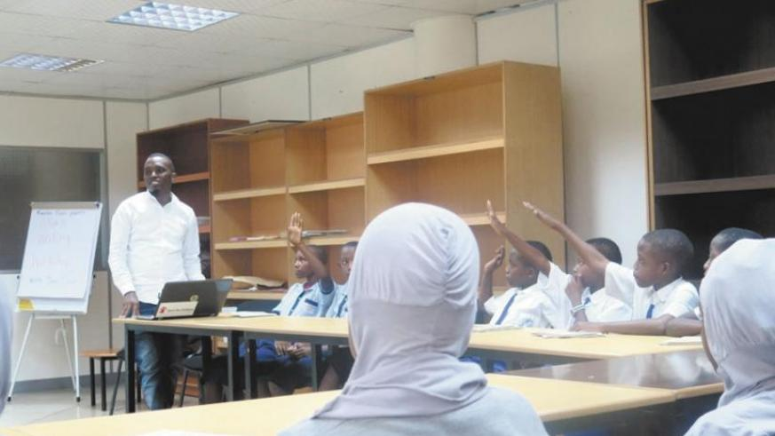 Students actively respond to questions from the star. (Solomon Asaba)