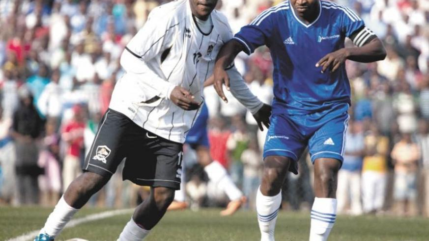 Charles Tibingana,(left), has been offered a one-year contract by Malawian league champions Big Bullets FC. (T. Kisambira)