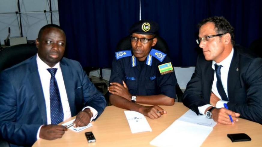 L-R; Siboyintore, Kuramba and Carvelli during a news briefing in Kigali yesterday. The US has offered up to $5m for information leading to arrest of each of the key nine Genocide fugitives. (Courtesy)