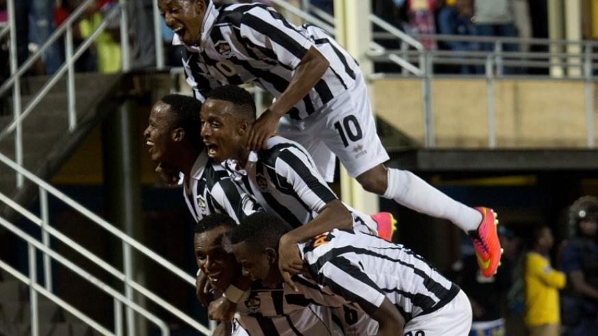 APR players celebrate after defeating Rayon Sports last season. The league champions start their title defence today against Etincelles. (File)