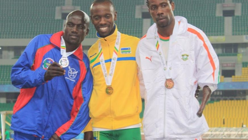 Muvunyi (C) poses with silver medalist Elias Ndimulunde (L) from Namibia and bronze winner Jean Luc Noumbo (R) from Cote d'Ivoire. (Courtesy)