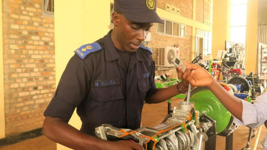 Eng. Senior Superintendant Kalisa explains how the training equipment operate. (All photos by S. Rwembeho)