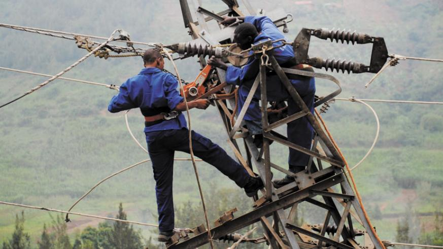 Workmen fix an electricity line. Top executives say aging power infrastructure is still a challenge. (File)