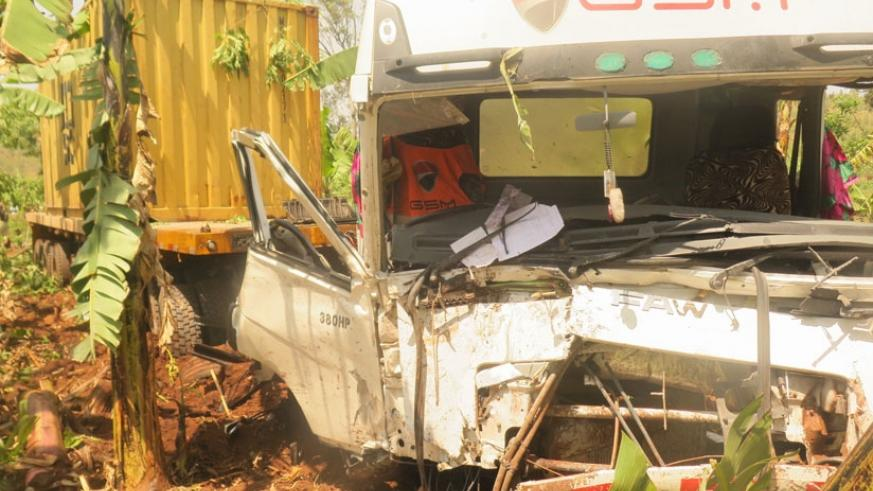 The cargo truck that smashed into an oncoming minibus. The driver was later arrested by the Police. (Stephen Rwembeho)