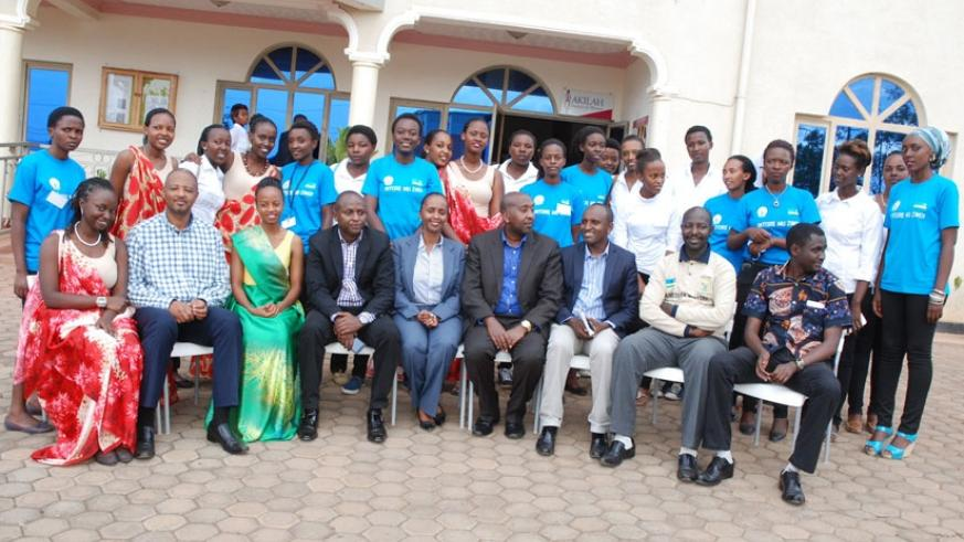 Officials, teachers, trainers and the students pose for a group photo at the inauguration of Itorero activities at Akilah Institute. (Julius Bizimungu)