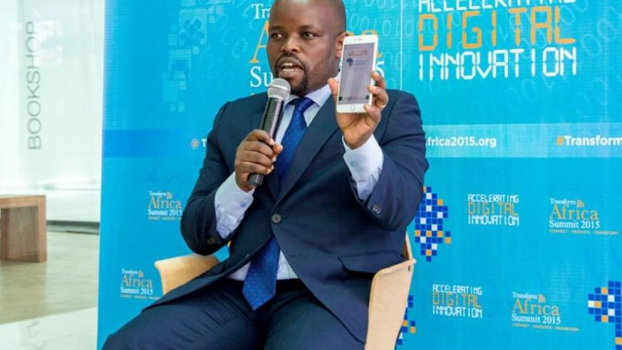 Youth and ICT minister Jean Philbert Nsengimana shows the Transform Africa web site using the QR Scan Code in Kigali yesterday. (Doreen Umutesi)