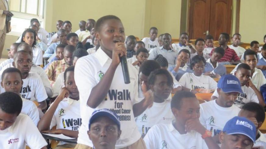 A student asks a question about childhood cancer during the meeting in Kigali on Saturday. (Michel Nkurunziza)