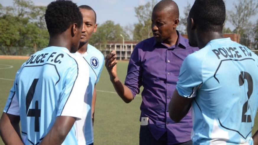 Police head coach Andre Cassa Mbungo talks to his players at half time on Tuesday when his side thrashed Bugesera 3-0. (Sam Ngendahimana)