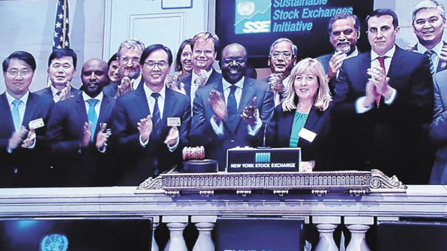 Rwabukumba (third left) joins Mukhisa Kituyi (centre), the UNCTAD Secretary-General, and other delegates from the UN SSI partner exchanges at the New York Stock Exchange after RSE was admitted as a partner exchange on Thursday. (Courtsey)