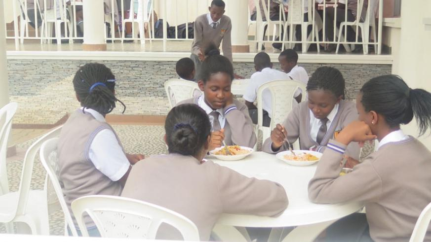 Excella students during lunch break. The Education ministry has banned canteens inside school compounds. (File)