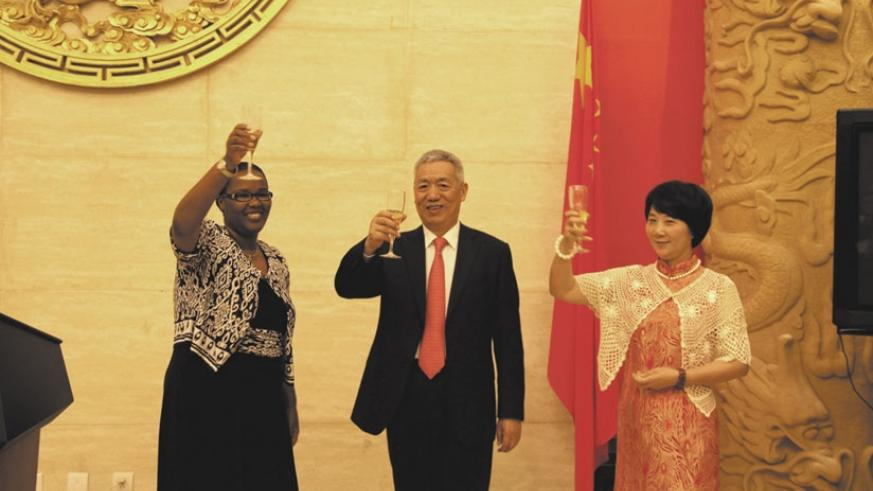 Agriculture Minister Geraldine Mukeshimana, Ambassador Shen Yongxiang and his wife toast to the good cooperation between Rwanda and China. (Courtesy)