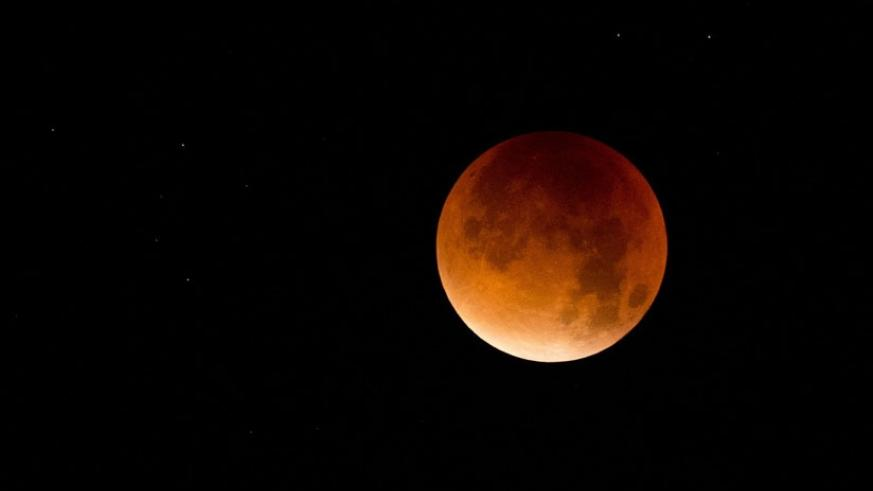 A supermoon is seen at the start of a lunar eclipse above Lisbon, Portugal in the early hours of Monday, Sept. 28, 2015. (Internet photo)