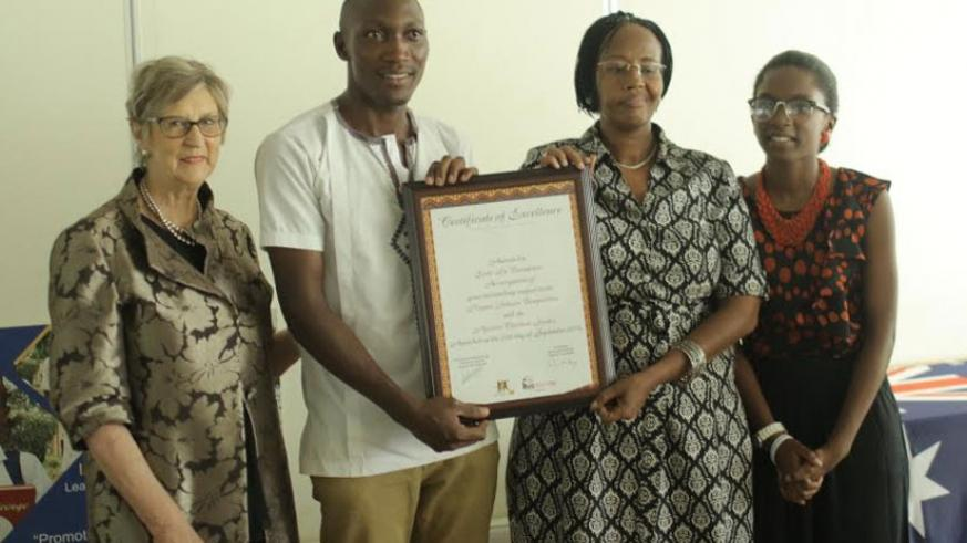 Ecole La columbiere representatives (middle) display the certificate of excellence after winning the competition. With them is Di Fleming (left) and Uwase (right). (Courtesy)