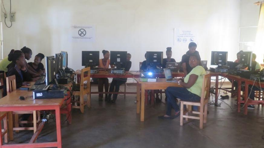 Girls at WDGS interact during a computer science lesson. (Elizabeth Buhungiro)