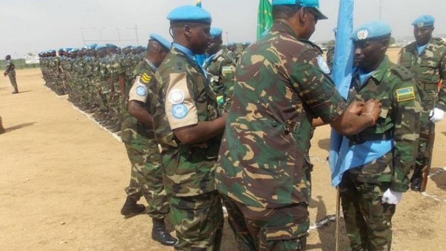 An RDF officer being decorated in Darfur yesterday.