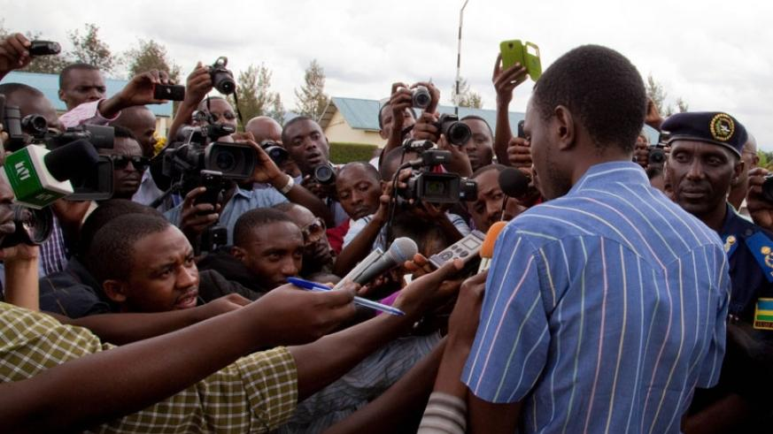 Journalists interview a suspect paraded at the Police headquarters in Kacyiru.   (File)