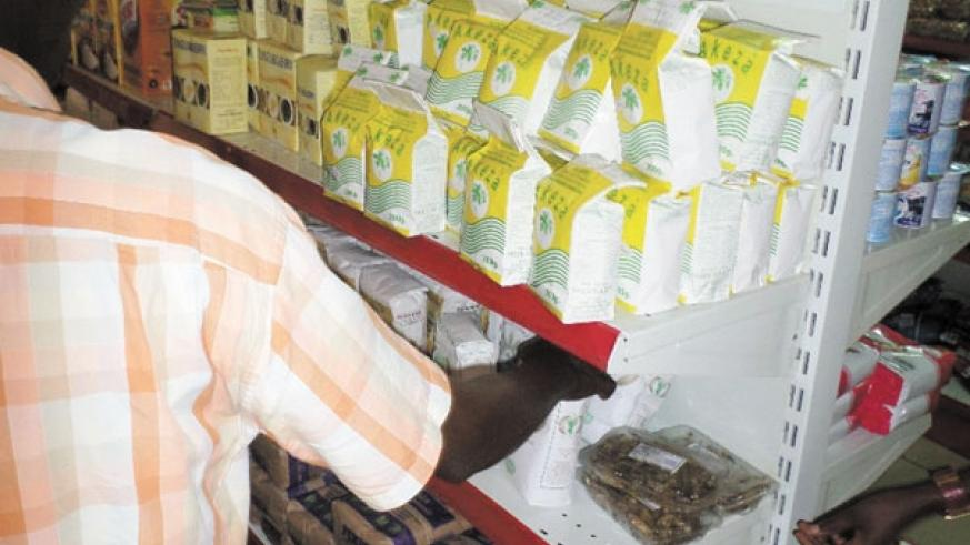 A shopper examines assorted fortified foods, including baby soya, at a city supermarket. (File)