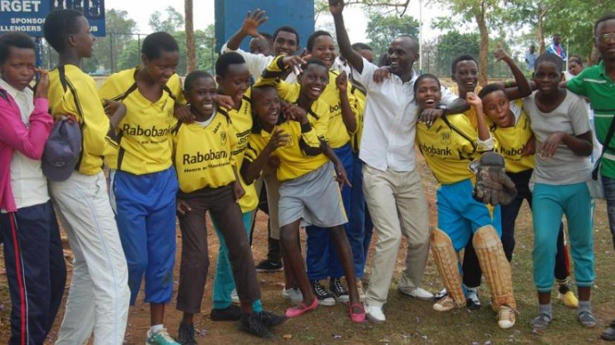 Kagarama SS boys' team celebrate after receiveing the trophy. (Courtesy)