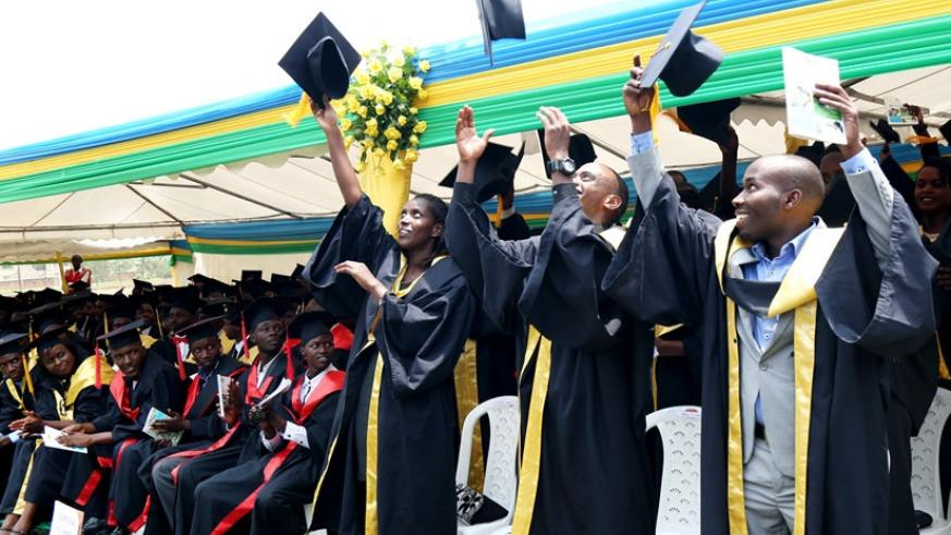 Graduates at IPRC Kigali toss their mortarboards during a graduation ceremony earlier this year. EAC is seeking to harmonise education system in partner states. (File)