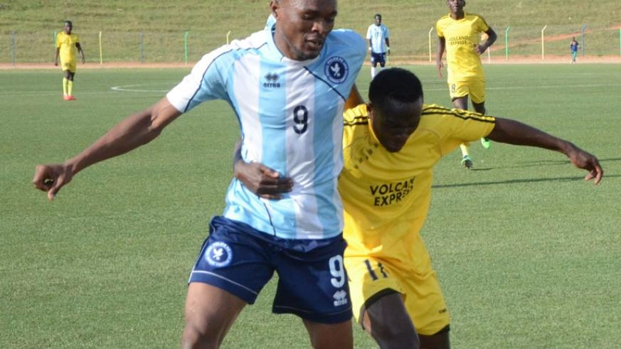 Police FC captain Jacques Tuyisenge (L) vies for the ball with a Mukura defender during the opening game of the season. Police lead the table after four matches. (S. Ngendahimana)