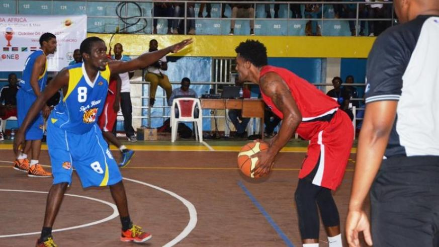 Mike Buzangu of CSK (R) in action against Tiger Head Power of Uganda in a previous game. He scored a game high 36 points in their game against  KPA yesterday. (Sam Ngendahimana)