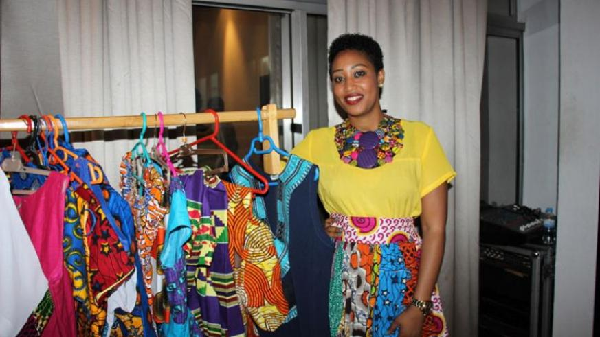 Uwase selling her beautiful and bright outfits at Hotel Des Mille Collines by Kempinski after the Rwanda Cultural Fashion Show 2015.