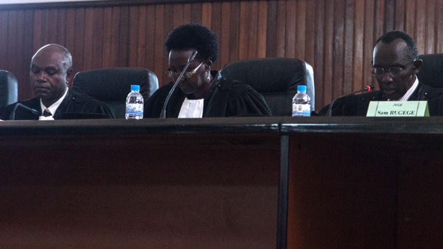 Chief Justice Sam Rugege (R) delivers the verdict at the Supreme Court earlier today. (Faustin Niyigena)