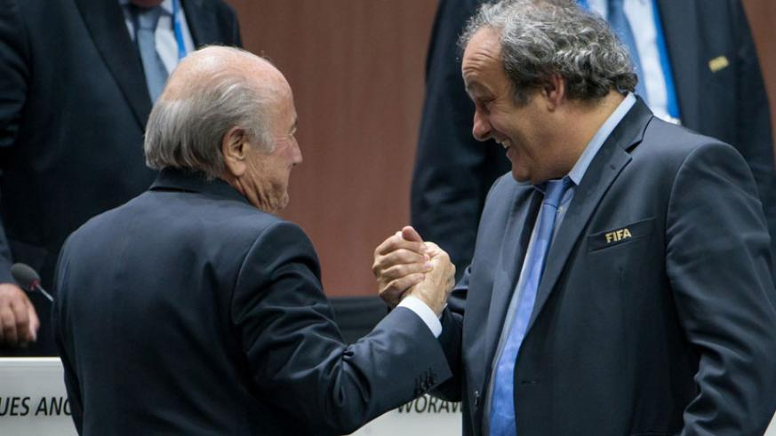 UEFA President Michel Platini (R) congratulates FIFA President Sepp Blatter after he was re-elected at the 65th FIFA Congress in Zurich. (Internet photo)