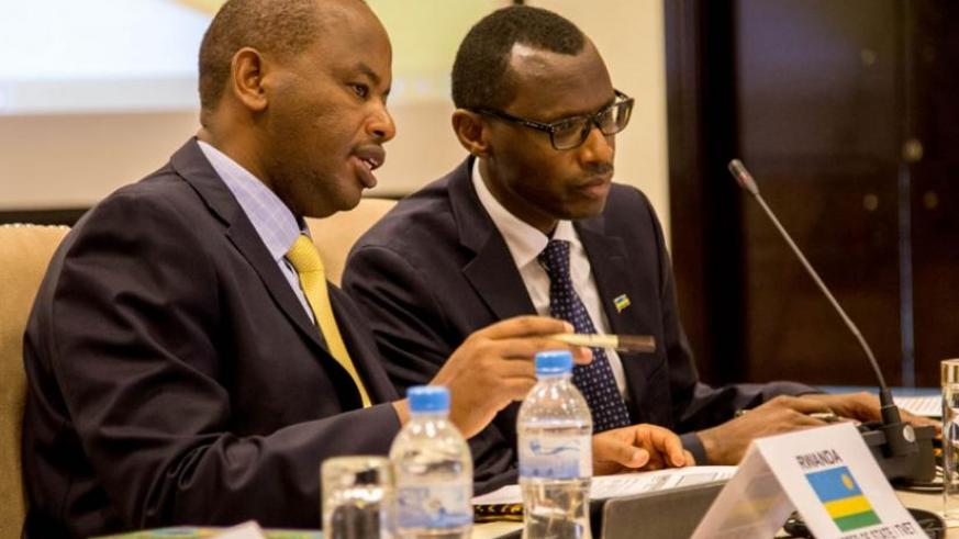 Albert Nsengiyumva, the state minister for TVET (L), and Papias Malimba Musafiri, PhD, the minister for education share ideas at the African Ministerial Conference on TVET in Kigali yesterday. (Doreen Umutesi)