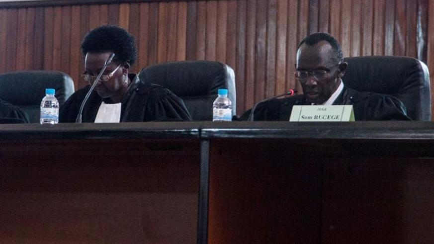 Chief Justice Rugege (R) delivers the verdict at the Supreme Court yesterday. (F. Niyigena)