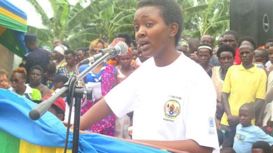 Honirine Uwase Hirwa, who spoke on behalf of girls, addresses the audience during celebrations to mark the International Day of the Girl Child in Fumbwe Sector, Rwamagana District, yesterday. (Stephen Rwembeho)