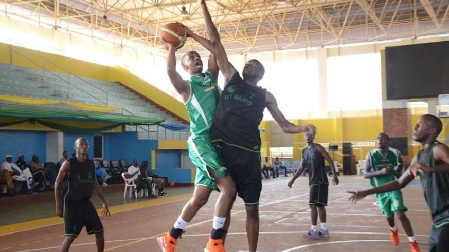 Lionel Hakizimana, left, of Espoir goes for a lay-up against Burundi's Dynamo in the group stage.  (Sam Ngendahimana)