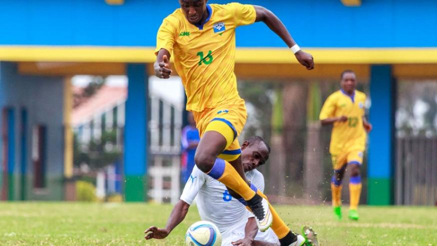 Ernest Sugira, seen here in action against Gabon defender Kabi Tchen Djesnot during a previous friendly game at Amahoro Stadium. The AS Kigali striker is likely to play a part in today's game against Tunisia. (Timothy Kisambira)