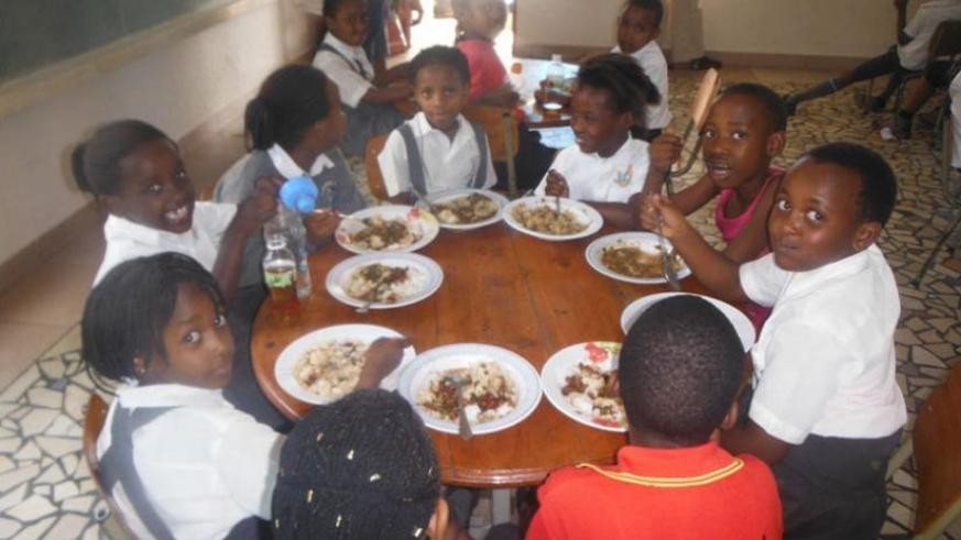 Pupils of Excella  School have their lunch. (File)